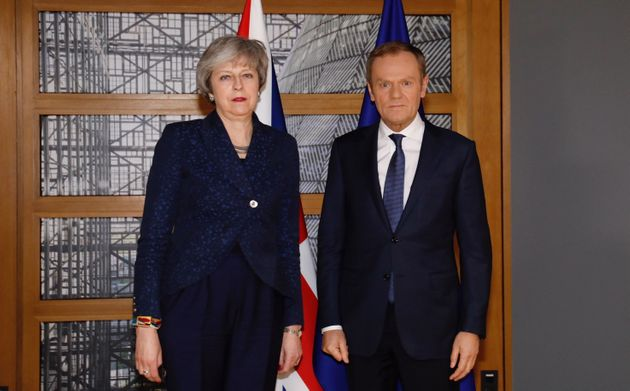 An unsmiling Theresa May with EU council president Donald