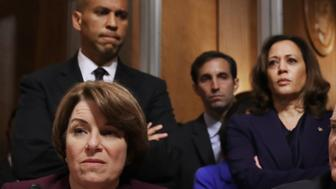 WASHINGTON, DC - SEPTEMBER 28: Senate Judiciary Committee members (L-R) Sen. Amy Klobuchar (D-MN), Sen. Cory Booker (D-NJ), Sen. Kamala Harris (D-CA), Sen. Chris Coons (D-DE) and Sen. Richard Blumenthal (D-CT) debate the confirmation of Supreme Court nominee Judge Brett Kavanaugh during a mark up hearing in the Dirksen Senate Office Building on Capitol Hill September 28, 2018 in Washington, DC. The committee agreed to an additional week of investigation into accusations of sexual assault against Kavanaugh before the full Senate votes on his confirmation. A day earlier the committee heard from Kavanaugh and Christine Blasey Ford, a California professor who who has accused Kavnaugh of sexually assaulting her during a party in 1982 when they were high school students in suburban Maryland. (Photo by Chip Somodevilla/Getty Images)
