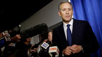 WEST LAFAYETTE, IN - FEBRUARY 07: Former Starbucks CEO Howard Schultz pauses as he talks to reporters at a news conference after speaking at Purdue University's Fowler Hall on February 7, 2019 in West Lafayette, Indiana. Schultz is considering running as an independent presidential candidate for the 2020 election. (Photo by Joshua Lott/Getty Images)