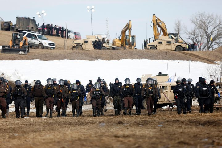 Law enforcement officers advance into the main opposition camp against the Dakota Access Pipeline near Cannon Ball, North Dakota, on Feb. 23, 2017.