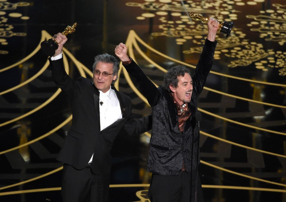"Mark Mangini and David White accept the Best Sound Editing Oscar for ""Mad Max: Fury Road"" in February 2016."