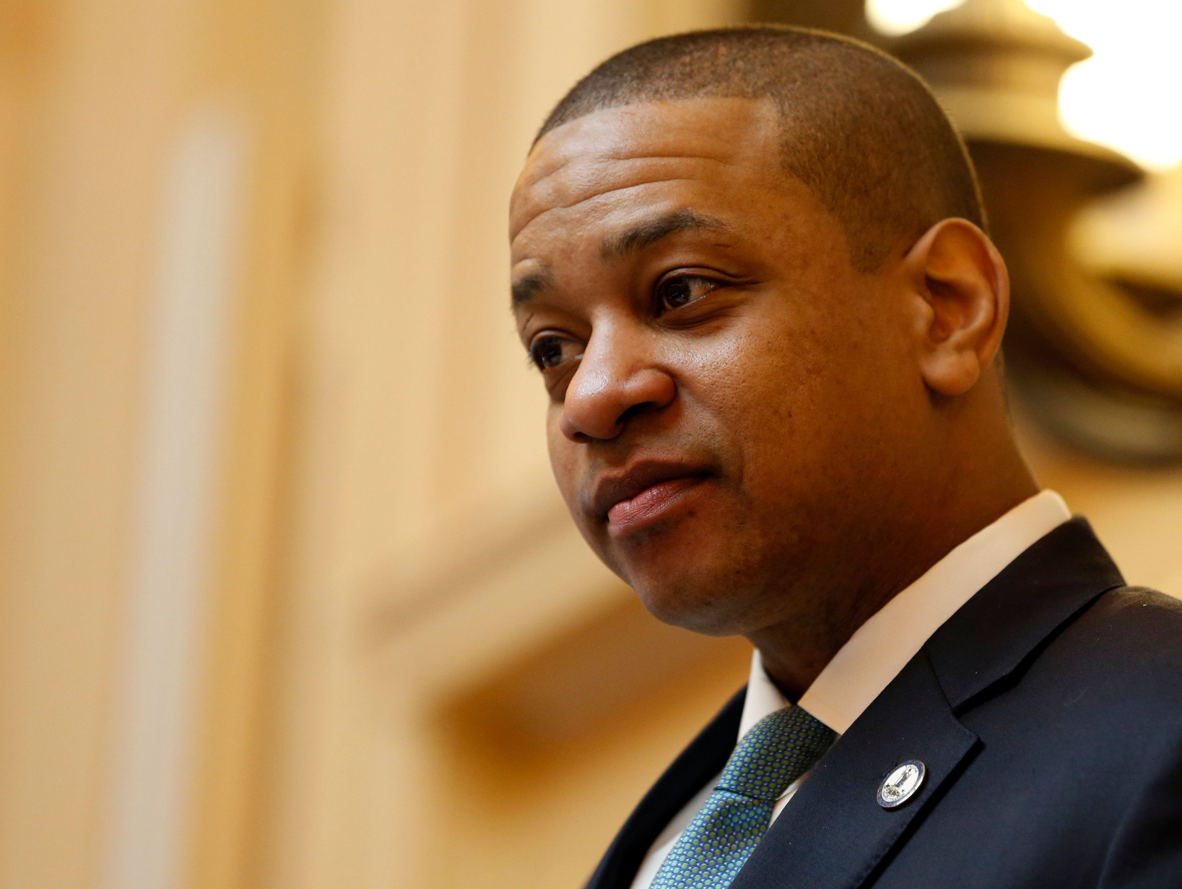 Virginia Lt. Gov. Justin Fairfax, seen presiding over the state Senate in Richmond on Monday, faces calls to resign and threa