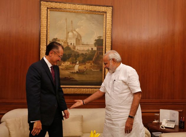 Prime Minister Narendra Modi (R) gestures to the World Bank President Jim Yong Kim (L) to sit while meeting...