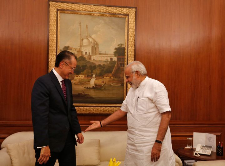Prime Minister Narendra Modi (R) gestures to the World Bank President Jim Yong Kim (L) to sit while meeting him in New Delhi in July 2014. Kim was on a three-day visit to India.