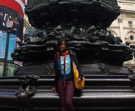 Anita Senaratna exploring London's Piccadilly Circus on her