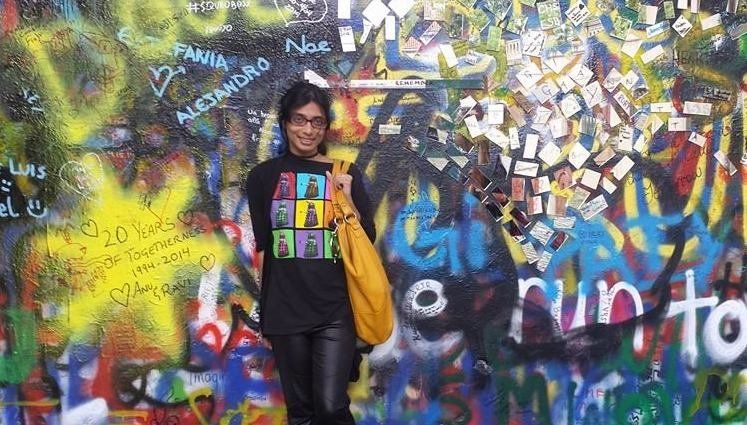 Senaratna in front of the famous John Lennon Wall in