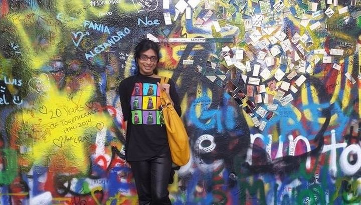 Senaratna in front of the famous John Lennon Wall in Prague.