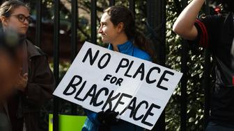 Protestors rally against Virginia Governor Ralph Northam outside of the governors mansion in downtown Richmond, Virginia on February 4, 2019. - Demonstrators are calling for the resignation of Virginia Governor Ralph Northam, after a photo of two people, one dressed as a Klu Klux Klan member and a person in blackface were discovered on his personal page of his college yearbook. Northam said that while he had not appeared in the photo, 'many actions that we rightfully recognize as abhorrent today were commonplace' and he was not surprised such material made its way to the yearbook. (Photo by Logan Cyrus / AFP)        (Photo credit should read LOGAN CYRUS/AFP/Getty Images)