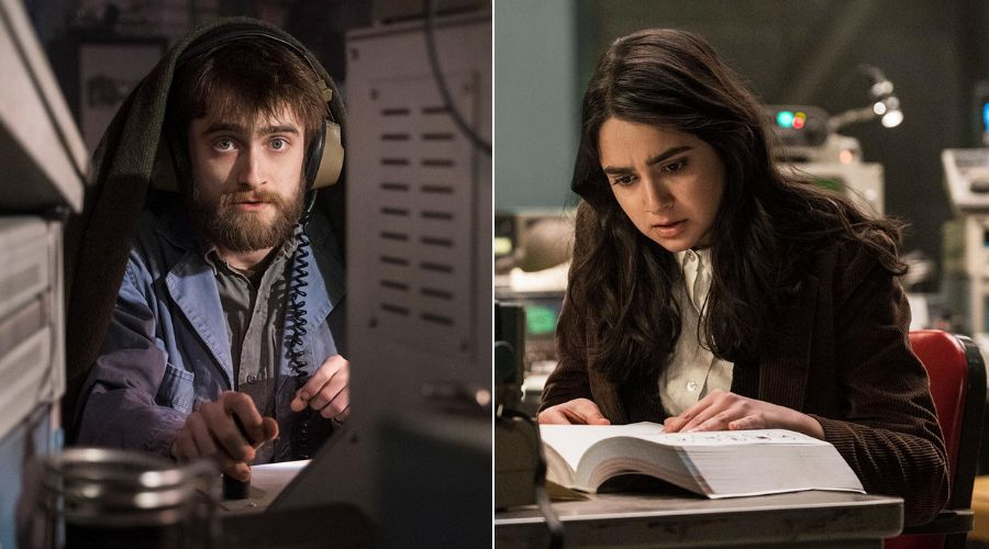 """Craig (Daniel Radcliffe) and Eliza (Geraldine Viswanathan), two angels toiling away on """"Miracle Workers."""""""