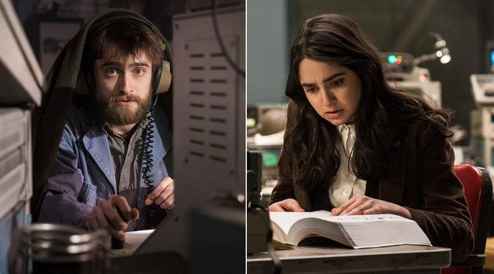 "Craig (Daniel Radcliffe) and Eliza (Geraldine Viswanathan), two angels toiling away on ""Miracle Workers."""