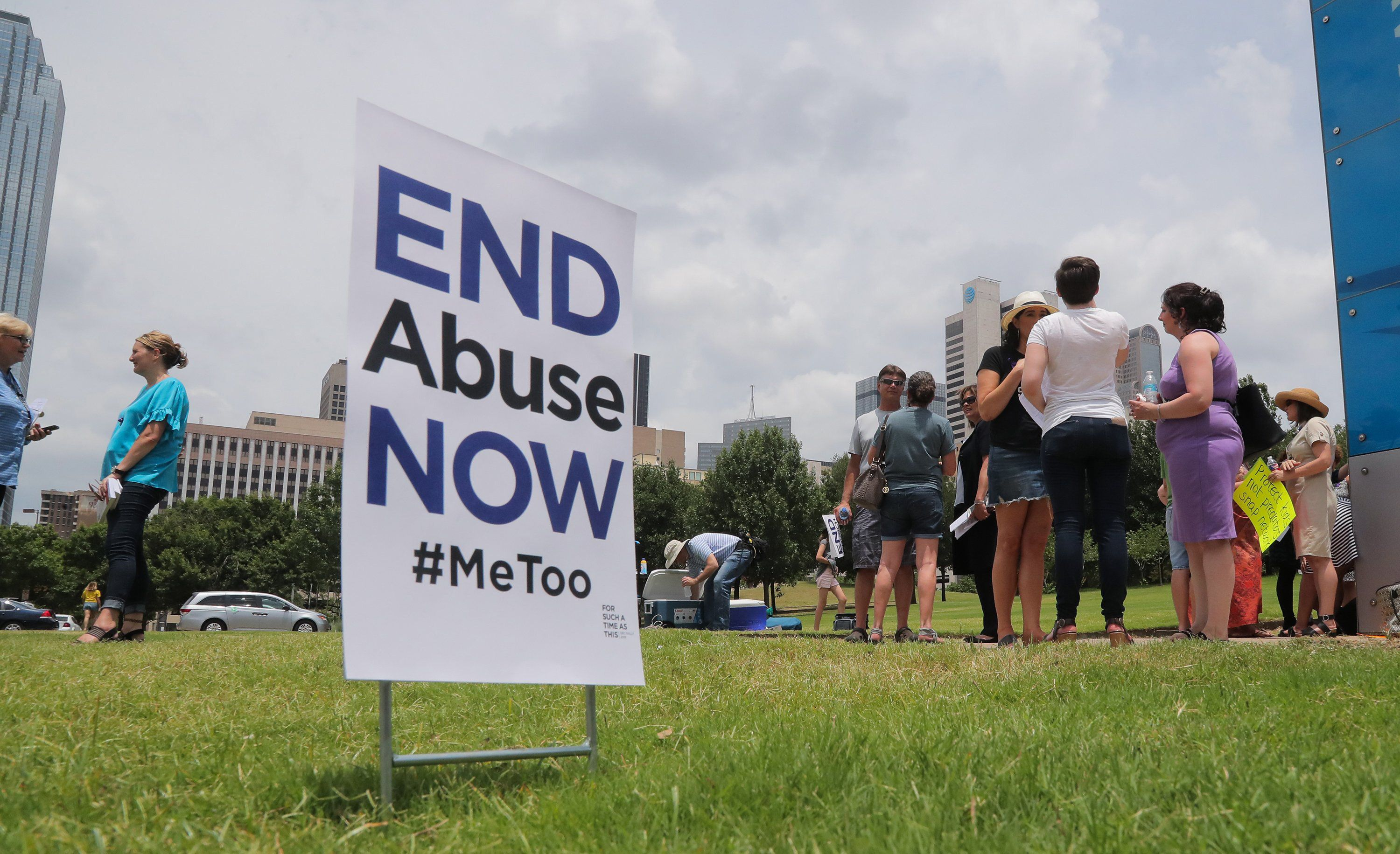 A small group of protesters fighting various forms of abuse within the church engage passersby outside at the Southern Baptist Convention meeting on Tuesday, June 12, 2018 in Dallas, Texas. (Rodger Mallison/Fort Worth Star-Telegram/TNS via Getty Images)