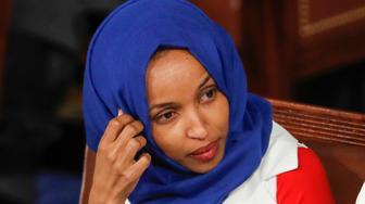 In this Feb. 5, 2019, photo, Rep. Ilhan Omar, D-Minn., left, joined at right by Rep. Rashida Tlaib, D-Mich., listens to President Donald Trump's State of the Union speech, at the Capitol in Washington. A tweet by Omar has sparked a bipartisan backlash, with some accusing her of being anti-Semitic. (AP Photo/J. Scott Applewhite)