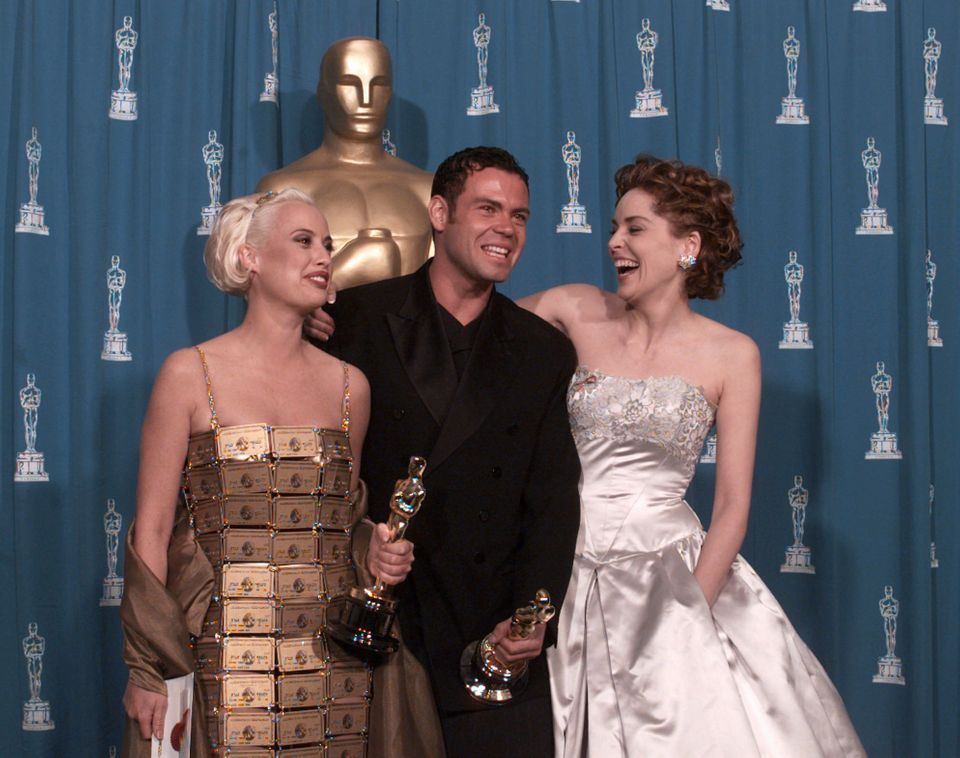 Lizzy Gardiner (left) and Tim Chappel, who won Best Costume Design in 1995, with presenter Sharon