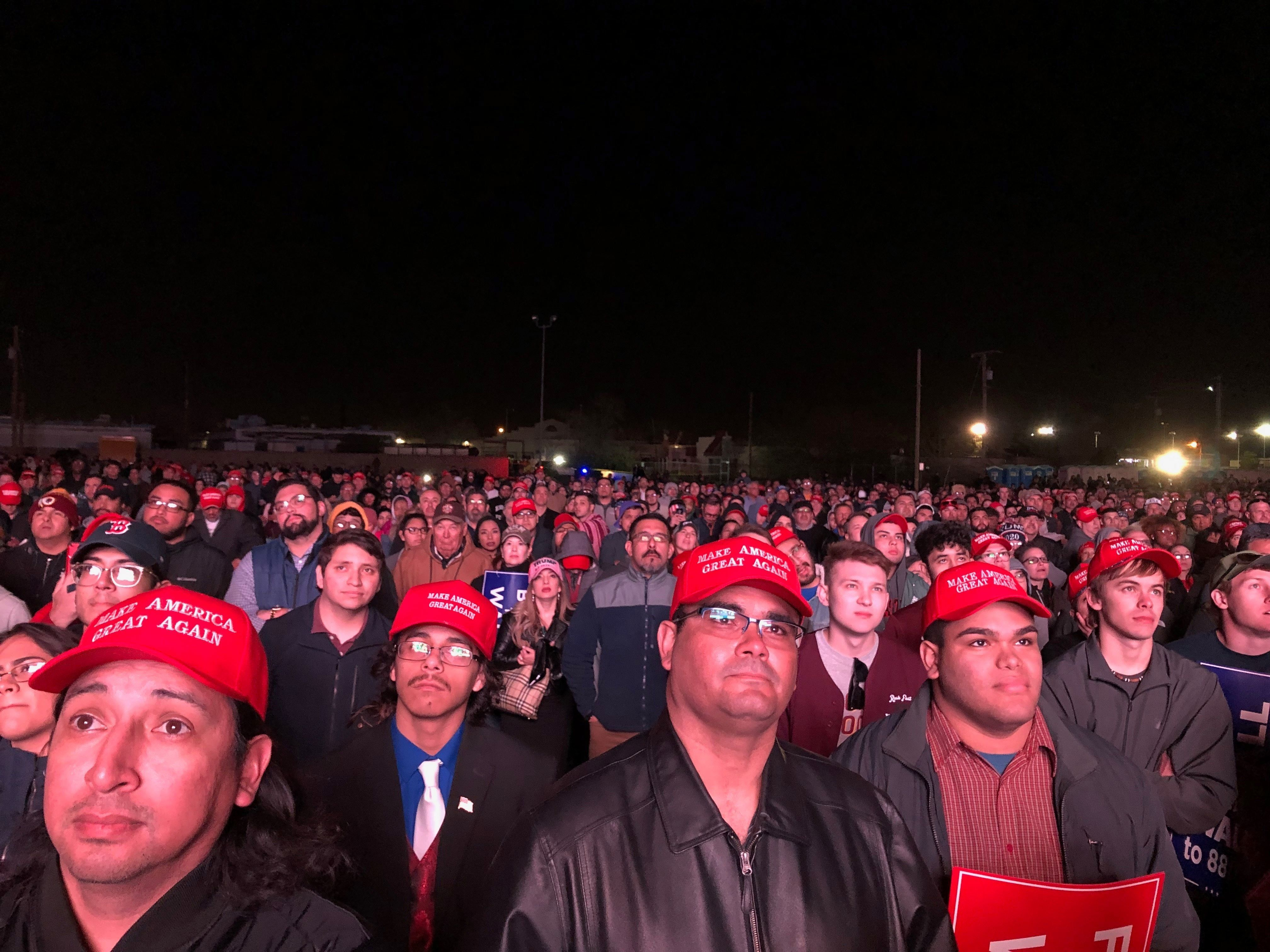 Trump supporters watch the president speak in El Paso, Texas on Feb. 11, 2019.