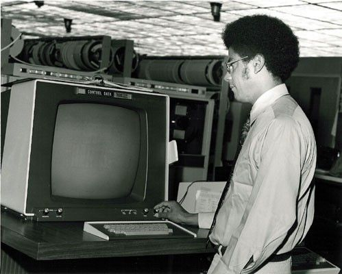 Washington at a computer terminal in his younger days.