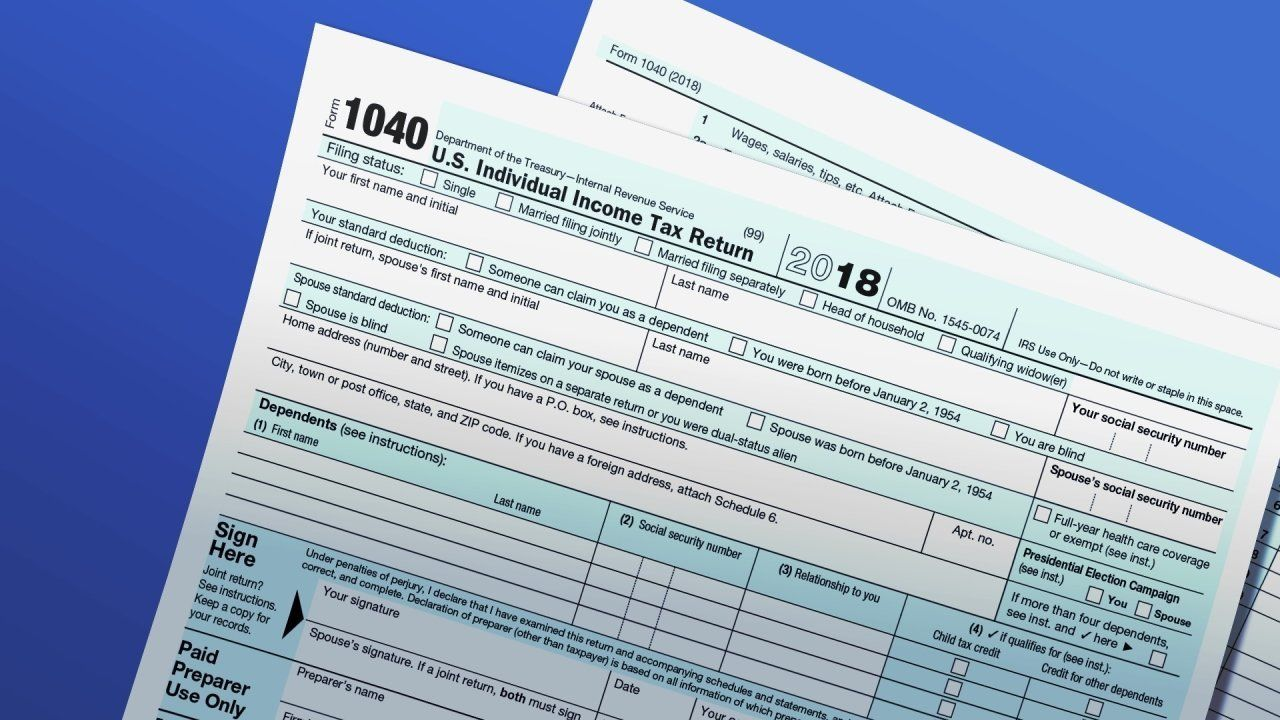 2018 1040 US INDIVIDUAL INCOME TAX RETURN forms on texture, partial graphic