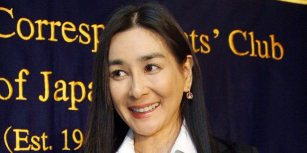 JAPAN - DECEMBER 18: Mariko Ishihara, actress and author, holds a her book titled 'Irregular Secrets'...