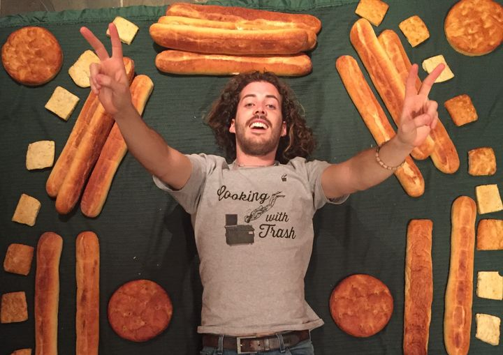 Cameron Macleish is surrounded by a haul of fresh bread after a dumpster diving session.