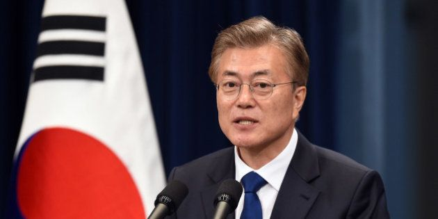 South Korea's new President Moon Jae-In speaks during a press conference at the presidential Blue House...