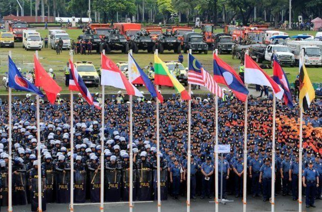 Security officers gather before a ceremony for the Association of Southeast Asian Nations (ASEAN) summit...