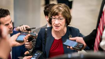 WASHINGTON, DC - JANUARY 24: On the 34th day of the partial government shutdown, Senator Susan Collins (R-ME) speaks to journalists while walking to the Senate floor for votes on competing Republican and Democratic plans to end the government shutdown on Capitol Hill in Washington, DC on Thursday January 24, 2019. (Photo by Melina Mara/The Washington Post via Getty Images)