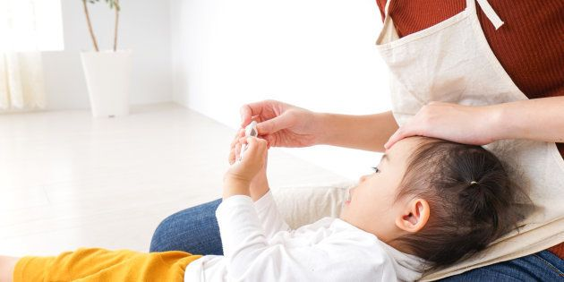 Nursery teacher care child having a