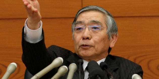 Bank of Japan (BOJ) Governor Haruhiko Kuroda attends a news conference at the BOJ headquarters in Tokyo,...