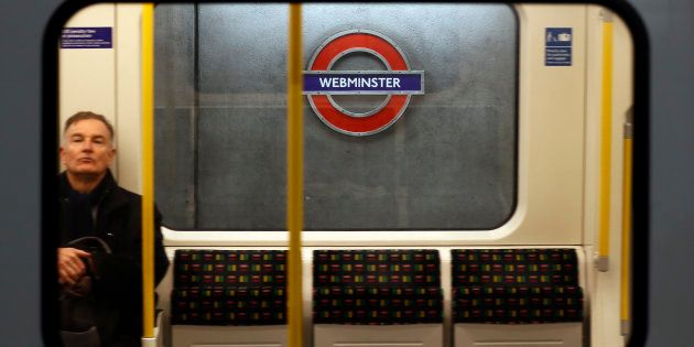A tube train passes a sign reading 'Webminster' after Amazon rebranded Westminster tube station as a...