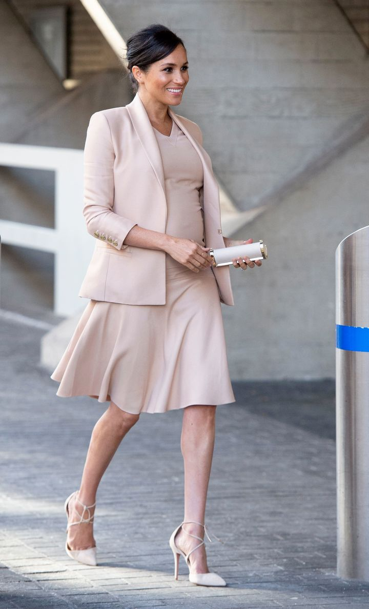 The Duchess of Sussex walks to her car after visiting the National Theatre in central London on Jan. 30, 2019, after it was announced that she would be patron of the theatre.