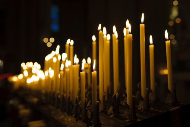 Lit Candles in Church Interior at