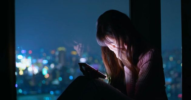 woman use phone and feel depression at