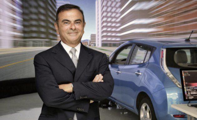ゴーン氏と日産の電気自動車「リーフ」
