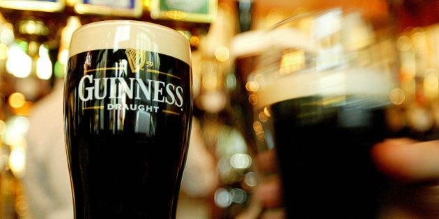 Pints of Guinness are seen in a London pub, March 1, 2004. The