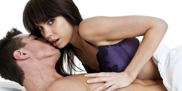 Man whispering in woman's ear woman pushing him