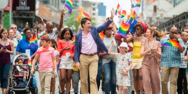 Prime Minister Justin Trudeau waves to the crowd as he, his wife Sophie Gregoire Trudeau and their children...