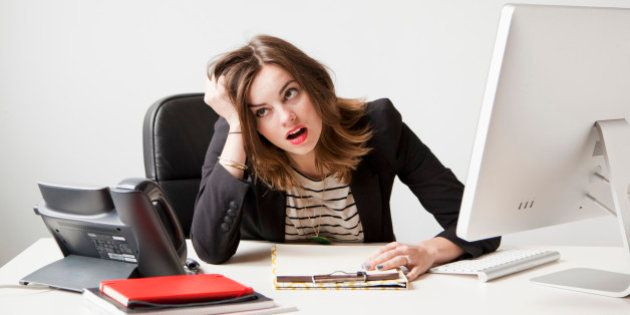 Studio shot of young woman working in office being under emotional stress