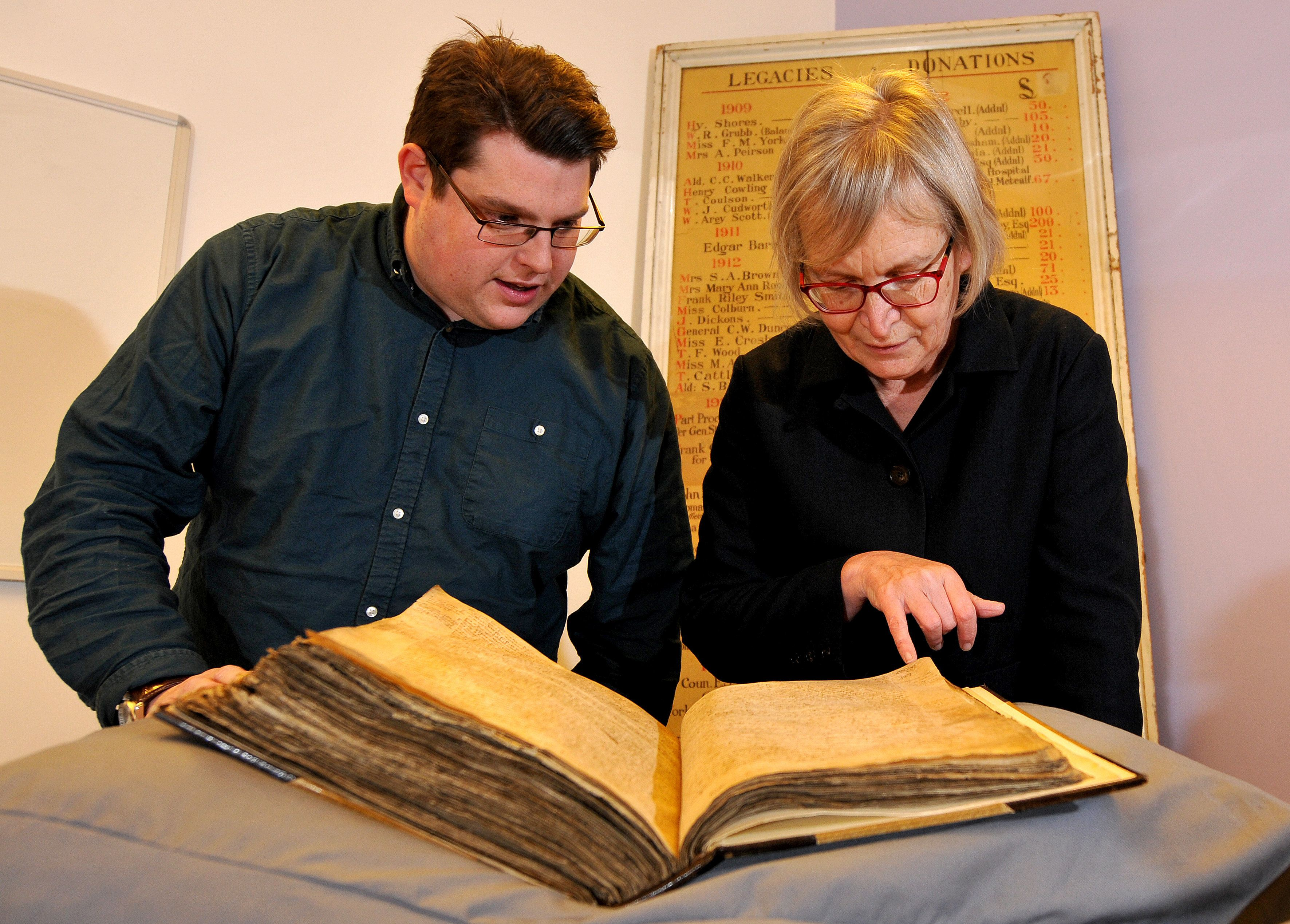 Gary Brannan, an archivist, and Sarah Rees Jones, director of the University of York's Centre for Medieval Studies, examine o