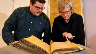 Gary Brannan, Archivist, and Professor Sarah Rees Jones examining one of the registers