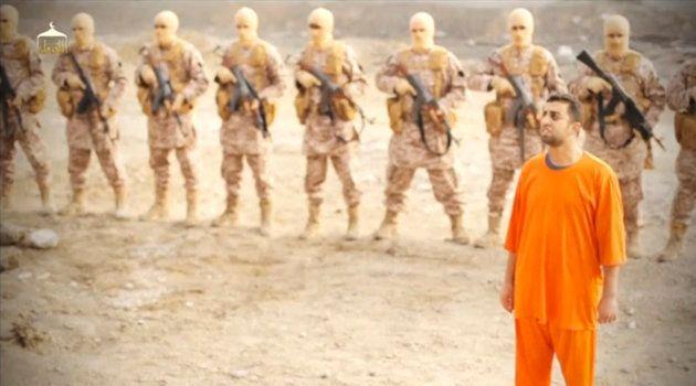 ISに捕まり、オレンジ色のつなぎを着せられた人