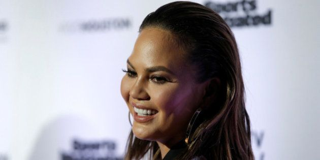 2017 Sports Illustrated Swimsuit Issue model Chrissy Teigen poses for photographers at a launch event...