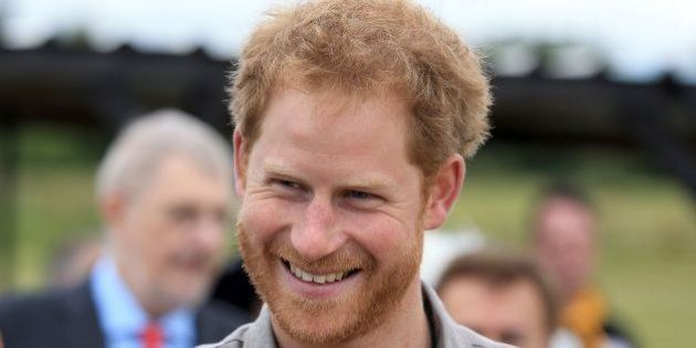 Britain's Prince Harry smiles as he visits The Blair Project at Three Sisters Racing Circuit in Wigan, north west England on July 5, 2016.Prince Harry joins school children with special educational needs or disabilities, as they become the first in the country to race their own computer designed race karts using new 3D printing and digital manufacturing technologies. / AFP / POOL / Clint Hughes        (Photo credit should read CLINT HUGHES/AFP/Getty Images)