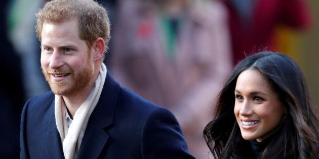 Britain's Prince Harry and his fiancee Meghan Markle arrive at an event in Nottingham, December 1, 2017....