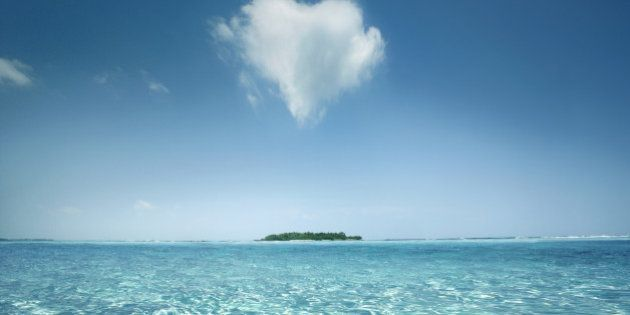 Heart shaped cloud over tropical