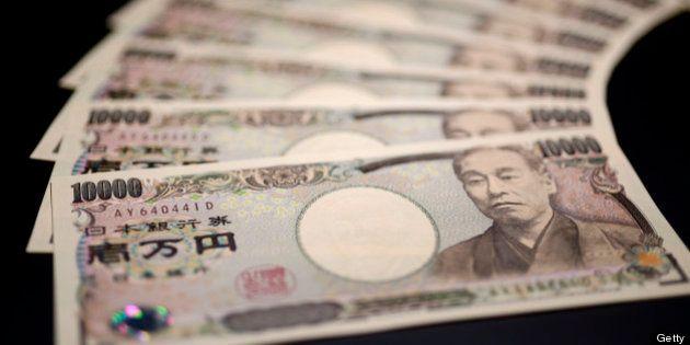 Japanese ten-thousand yen banknotes are arranged for a photograph in Kawasaki, Kanagawa Prefecture, Japan,...