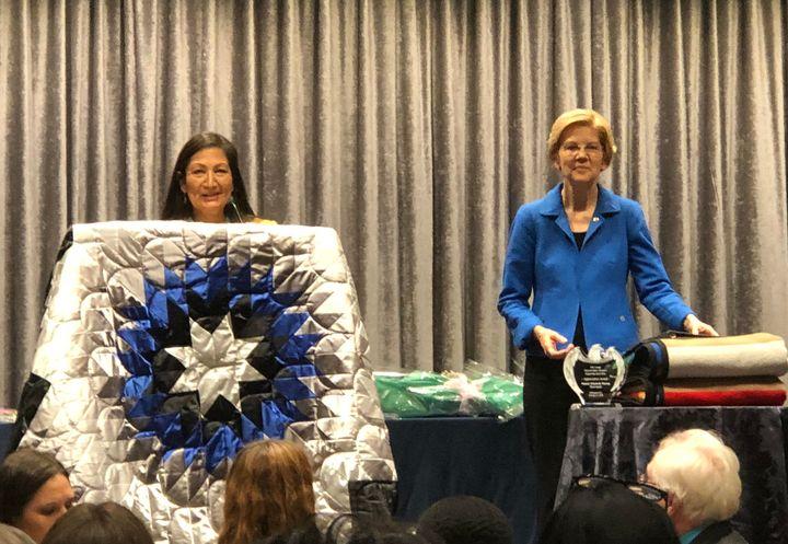 "Rep. Deb Haaland (D-N.M.) introducing Sen. Elizabeth Warren (D-Mass.) atthe National Indian Women's ""Suppor"