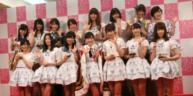 The top 15 members of Japan's all-girl pop idol group AKB48, from top left in clockwise, Aya Shibata,...