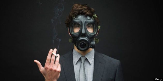 Businessman Wearing Gas Mask and Smoking