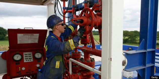 An employee works at Cuadrilla Resouces Ltd.'s shale gas exploration site in Singleton, U.K., on Tuesday,...