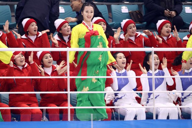 GANGNEUNG, SOUTH KOREA - FEBRUARY 10: North Korean cheerleaders sing and wave during the Women's Ice...
