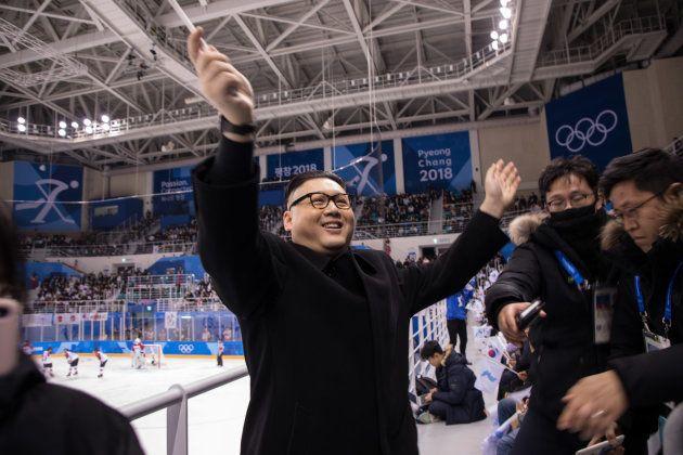 A man impersonating North Korean leader Kim Jong Un waves a unified Korean flag before North Korean cheerleaders...